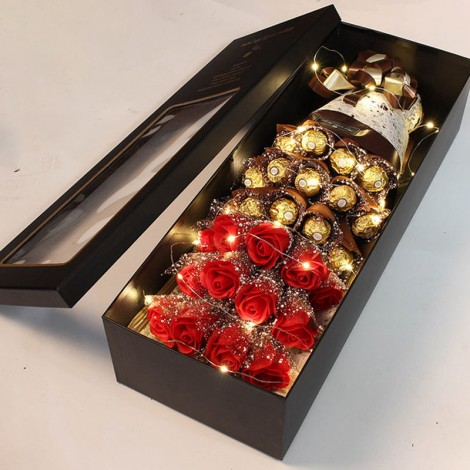 red rose with chocolate in box